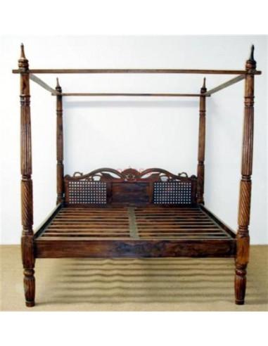 Letto a baldacchino testata intagliata in legno massello